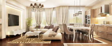 Large great room with walls of windows and their coverings all in neutral beige color scheme includes kitchen, dining and living room