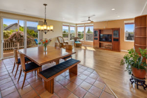 Corner windows from the family room and sliding glass doors from the dining area feature the views.