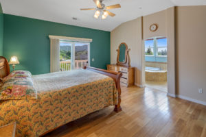 See the views from the sliding glass door leading from the master bedroom to the balcony and from the windows over the jetted tub in the bathroom extending from the bedroom