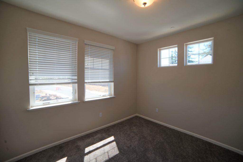 2059 Medano Dr Santa Rosa CA 95407 second Bedroom at the base of the stairs with medium short shag brown carpet