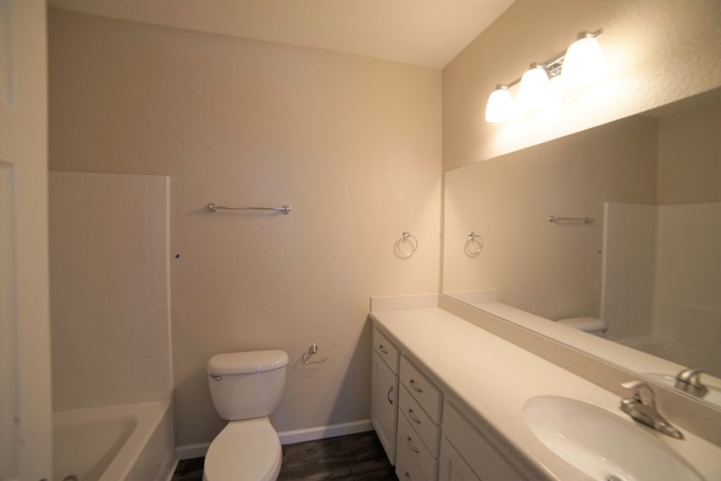The Main Bathroom Upstairs at 2059 Medano Dr has the same light tones as the lower level