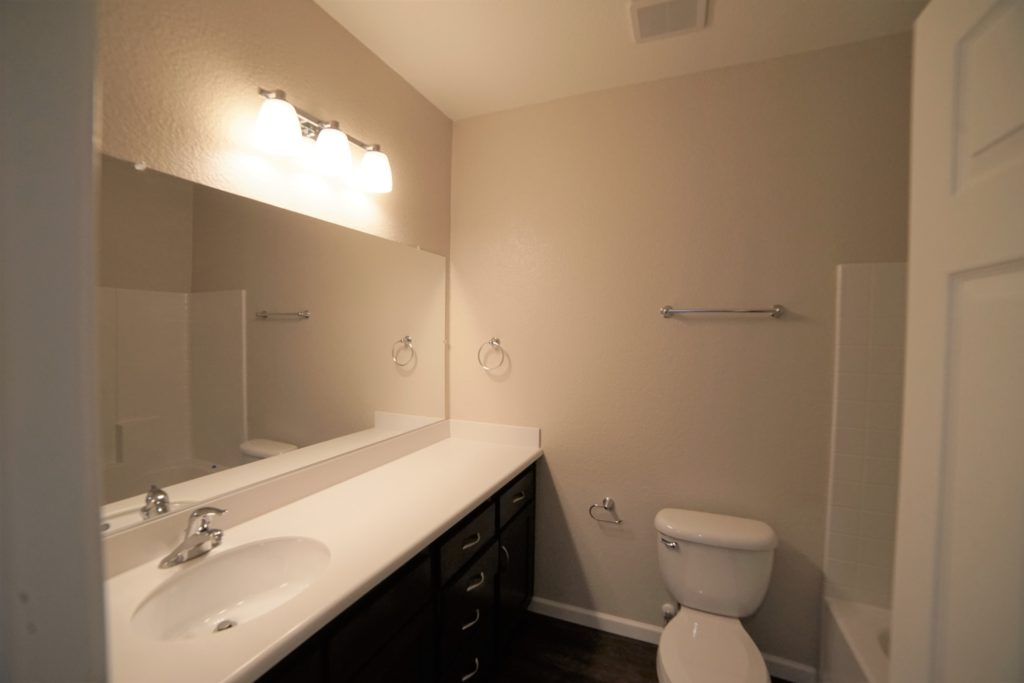 Upstairs main bathroom with toilet and vanity
