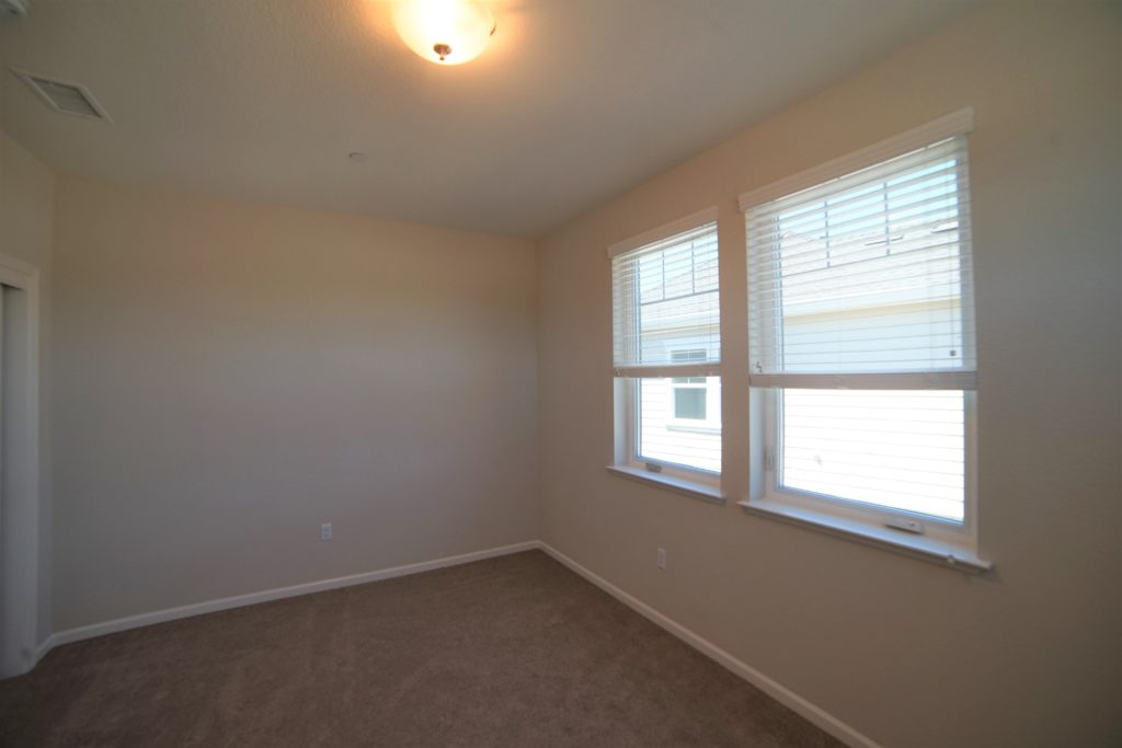 The third bedroom at 2057 Medando Dr has two large swinging windows andis west facing and backs into the other townhomes