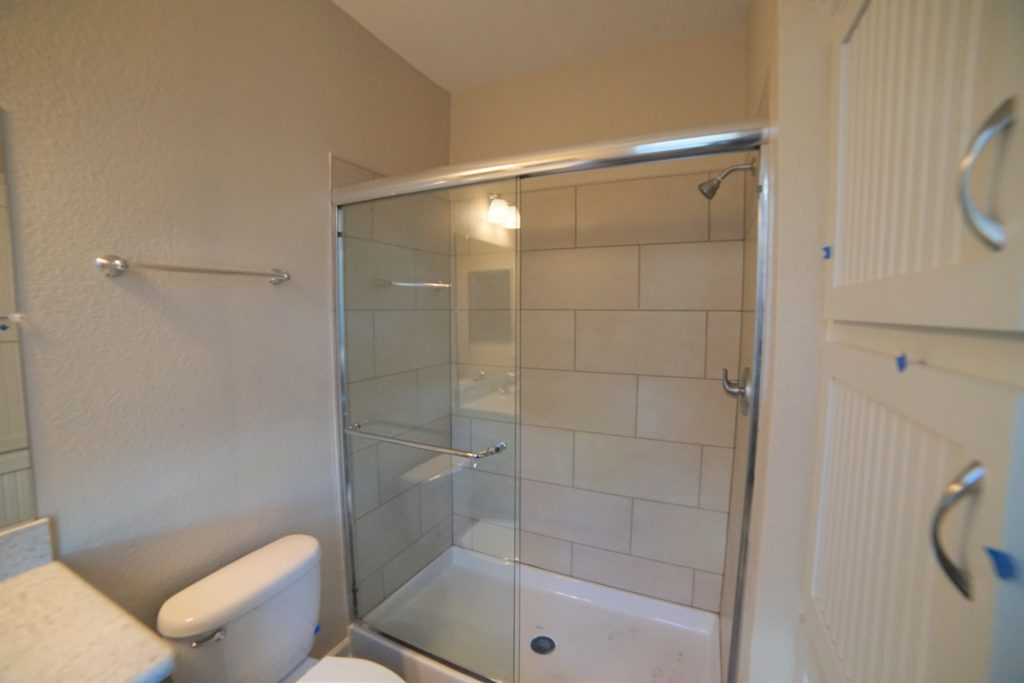 2059 Medano Dr santa rosa ca has a full bathroom downstairs with a walk in shower