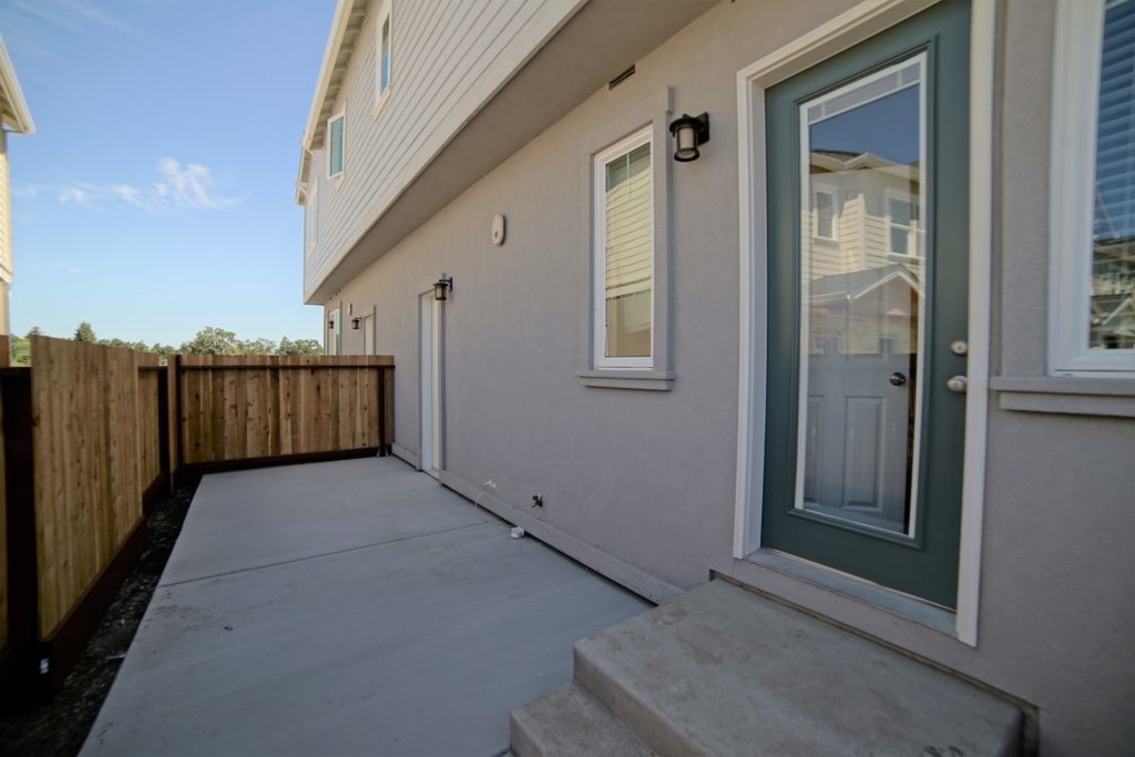 Personal backyard at 2059 Medano Dr with perimeter fence and access to garage and back of home