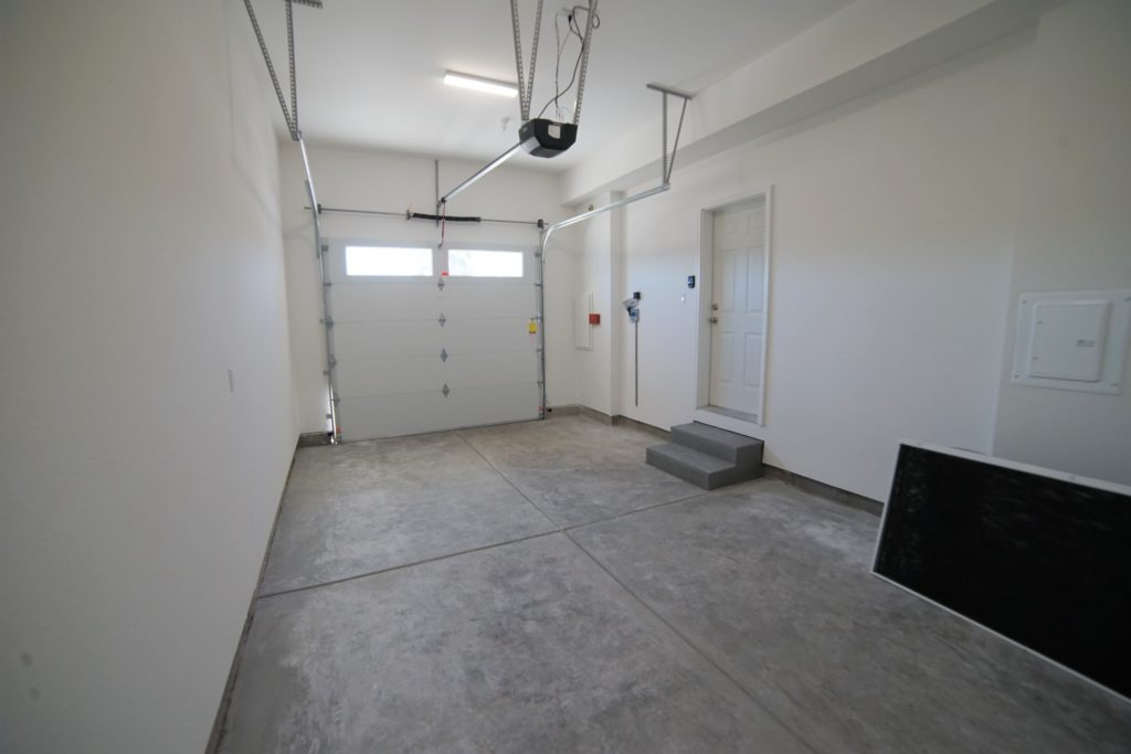 2059 Medano Drive single car garage with insulated automatic garage door on demand hot water heater fully finished