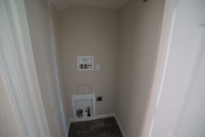Laundry closet with stackable washer and dryer hookups at 2057 and 2059 Medano Dr, Santa Rosa