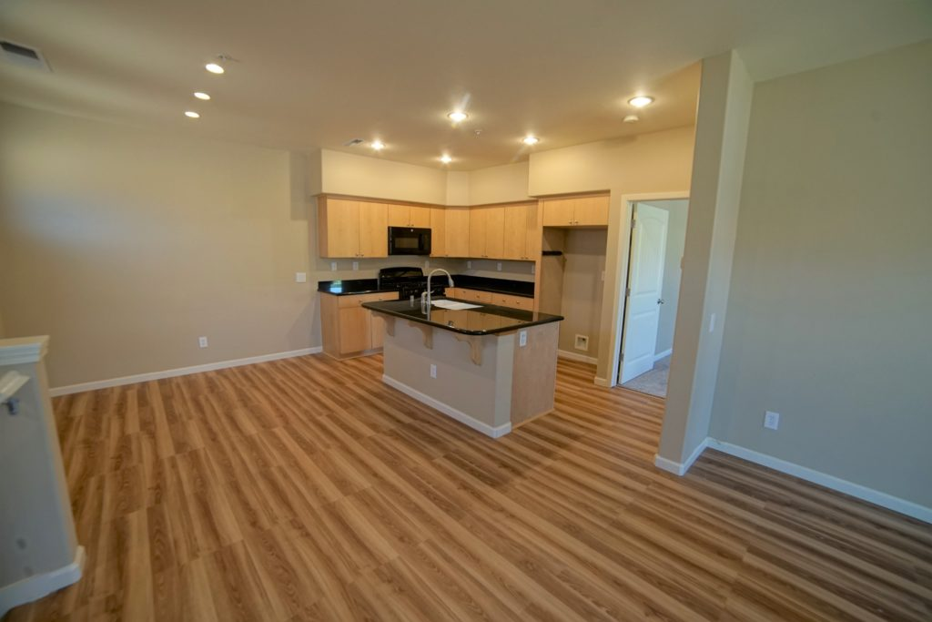 160 Healdsburg Ave Unit B Upstairs Kitchen and dining area with new appliances plank floors black granite counters