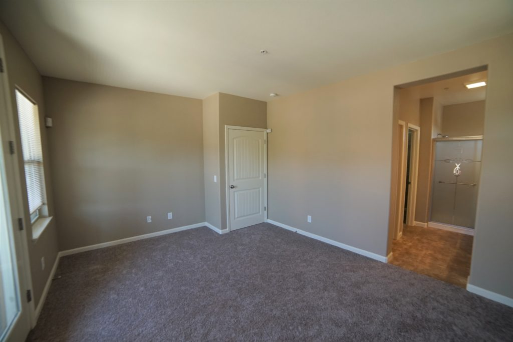 160 Healdsburg Ave Unit B has a Lovely master bedroom with walk in shower a separate toilet room and a walk in closet and has the same tan and white tone and new carpet. The bathroom floor is 12 inch tile