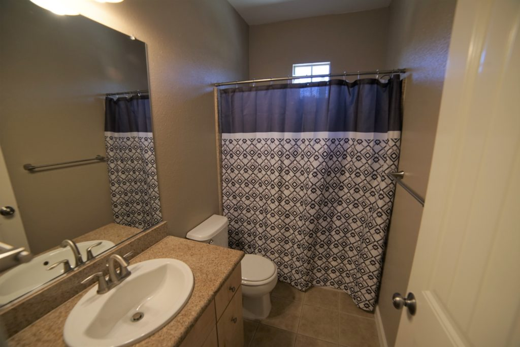 This is the main bathroom with the same tan tones and white trim and tan granite surround in the shower over tub and vanity. Just as the other side of 160 Healdsburg Ave Unit B is separate, this side of the stairs includes the second bedroom, the main bathroom and the laundry closet.